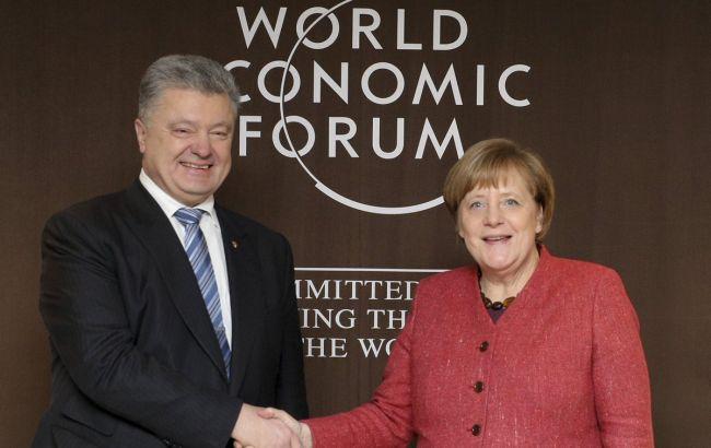 Порошенко начал переговоры с Меркель в Давосе