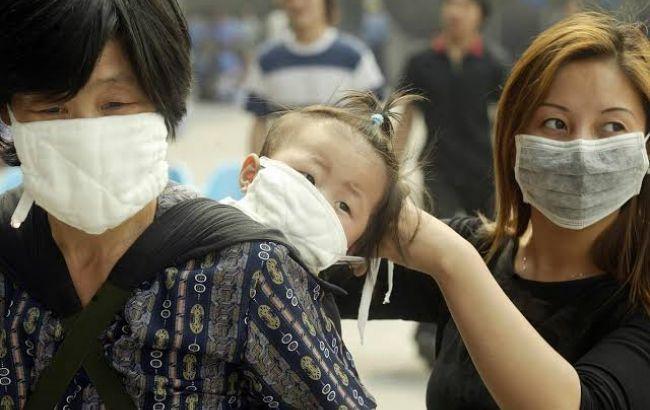 Число хворих на коронавірус у Китаї наближається до 8 тисяч