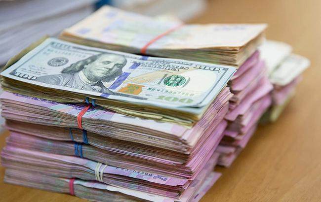 Фото: взятка в долларах (facebook.com nabu.gov.ua)