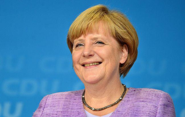 Меркель видит прогресс в торговых переговорах между США и ЕС