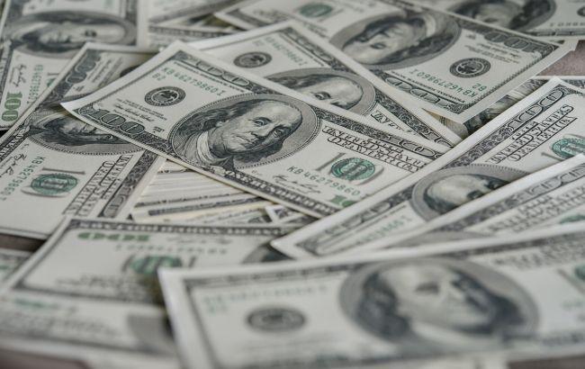 Курс доллара приостановил снижение на межбанке