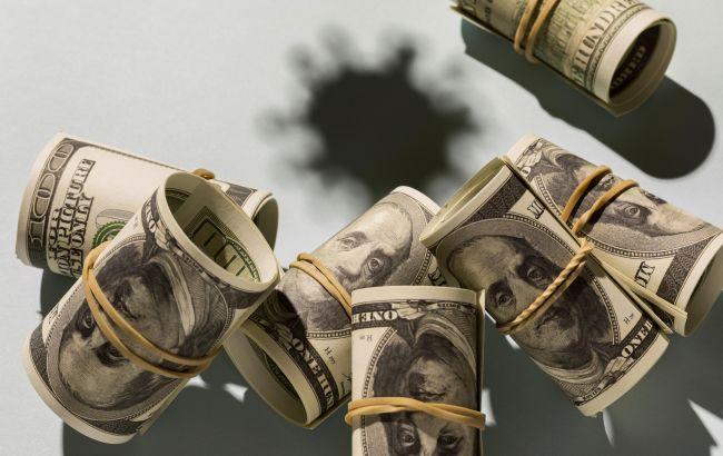 Курс доллара закрылся небольшим ростом на межбанке