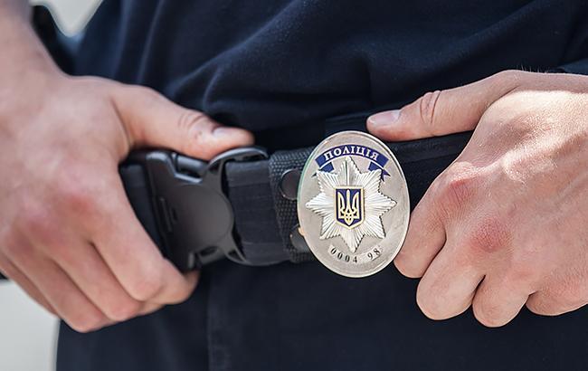 Фото: Полицейские задержали преступника (РБК-Украина)