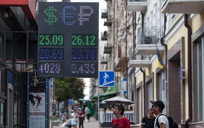 Наличный курс доллара в продаже понизился до 26,41 гривны/доллар