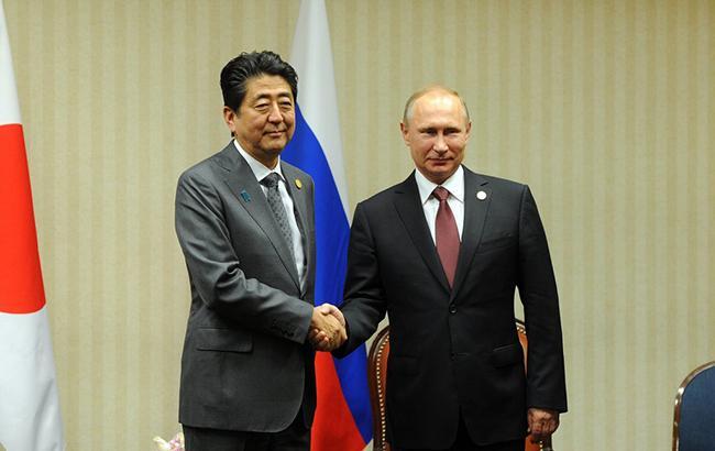 Фото: Сіндзьо Абэ и Владимир Путин (kremlin.ru)
