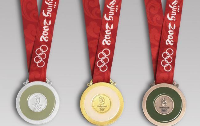 Фото: Олімпійські медалі 2008 року (megabook.ru)