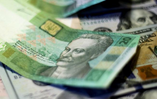 Курс гривни намежбанке впятницу снизился до27,07 грн/$1