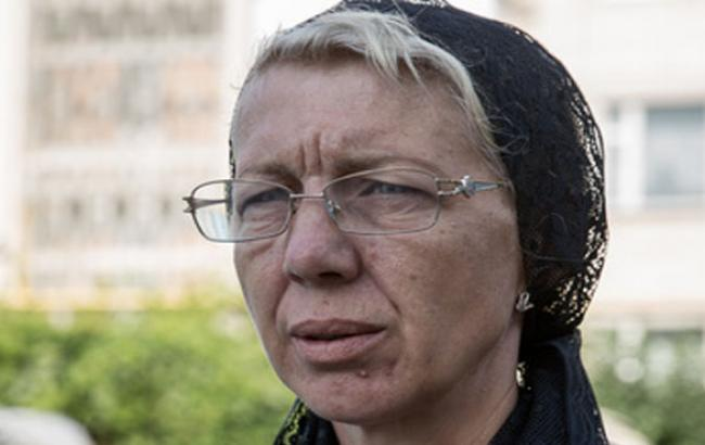 Фото: Людмила Менюк на похоронах сына (facebook.com)