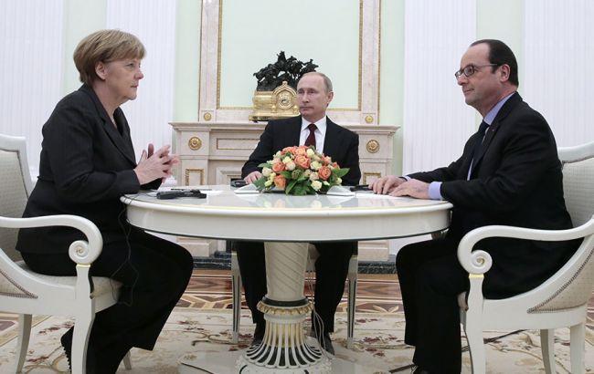 Фото: Путін, Меркель і Олланд провели телефонні переговори