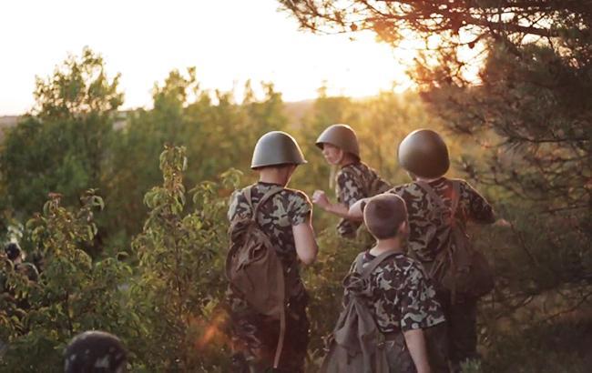 Фото: На стороне боевиков воевали дети (my-camp.wix.com/fortis)