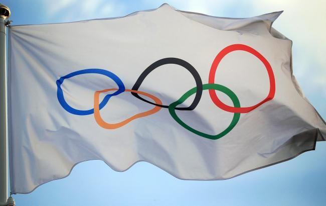 Фото: флаг Олимпийских игр (olympic.org)