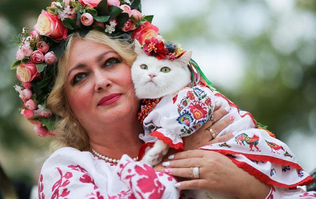 Фото: Кішка Білочка і її власниця (РБК-Украина)