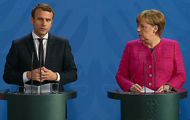 Фото: Эммануэль Макрон и Ангела Меркель (Présidence de la République)