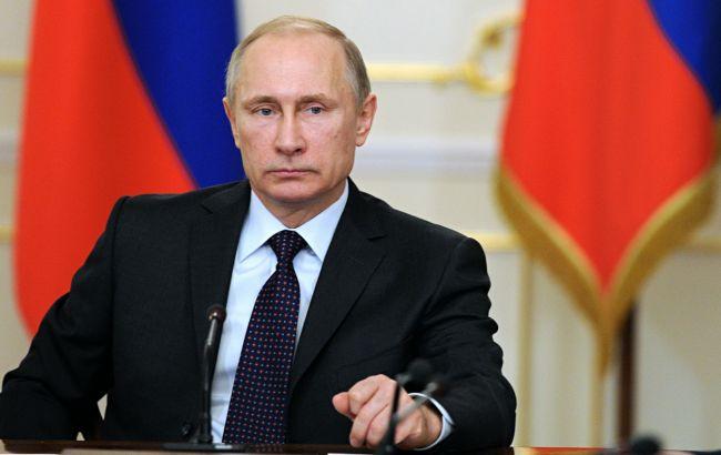 Фото: Путін пророкує проблеми з закликом