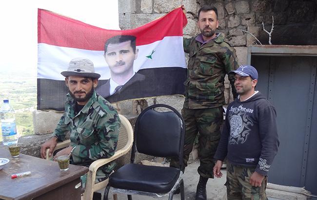 Народ Башара Асада: божественный свет, человек на Луне и века геноцида
