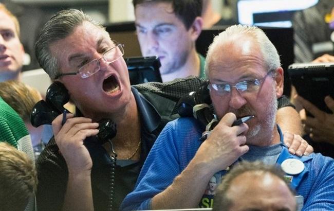 Паніка на біржах у різних країнах: фото, відео