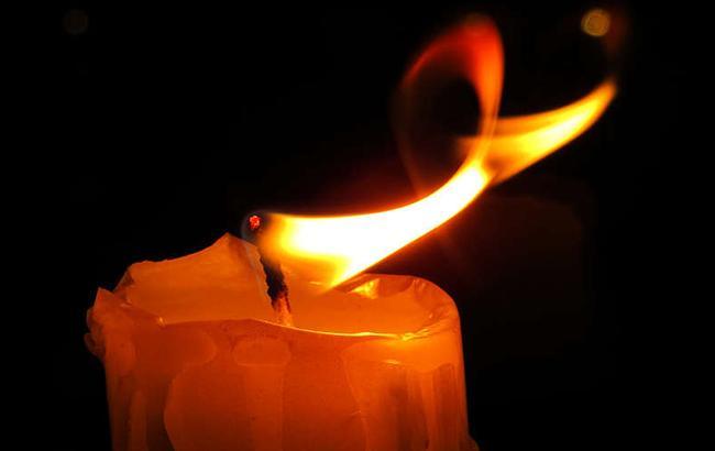 Фото: Траурная свеча (torange.biz)