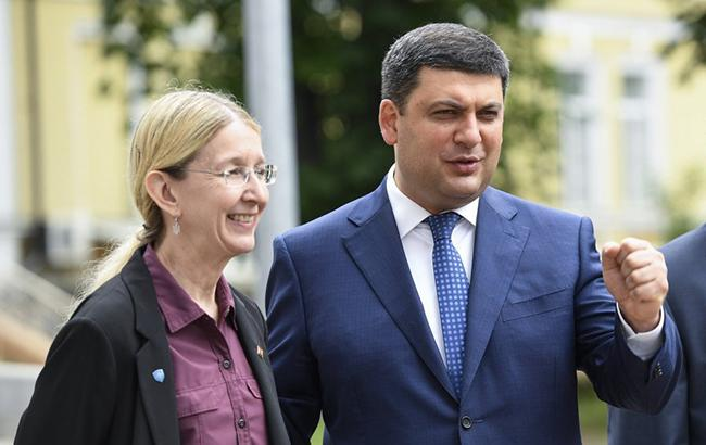 Уляна Супрун Володимир Гройсман обіцяють, що в 2019 році медреформа буде продовжуватися (УНІАН)